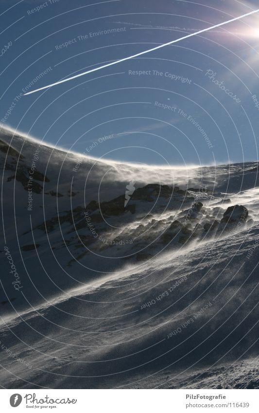 Windig Himmel blau weiß Sonne schwarz kalt Schnee Berge u. Gebirge Stein braun Felsen fliegen Flugzeug Spuren Skier