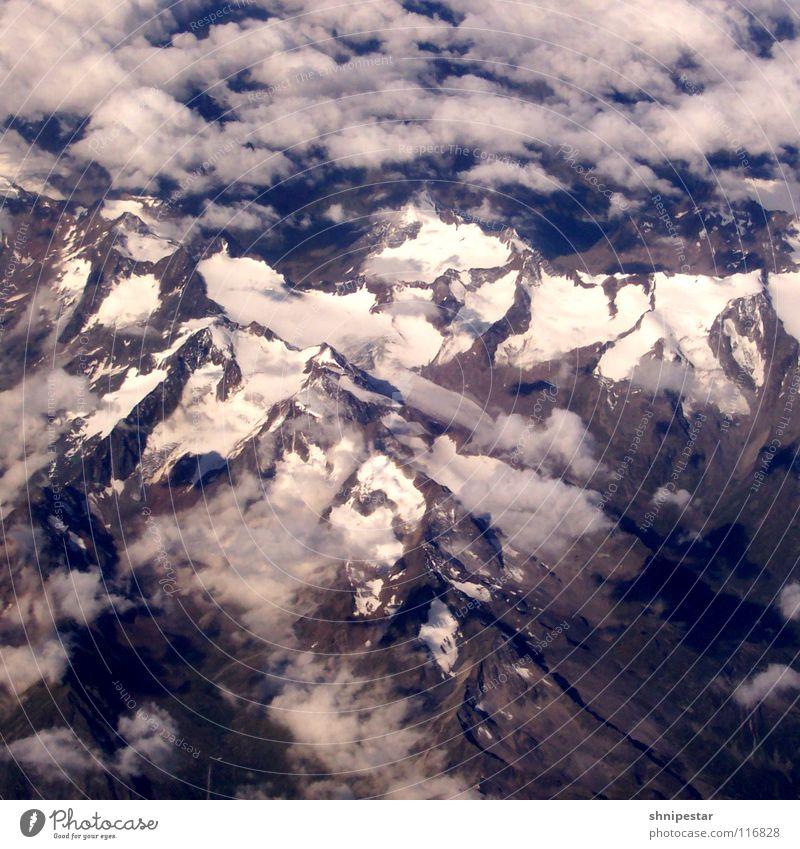 Die Alpen Ferien & Urlaub & Reisen Winter Schnee Berge u. Gebirge Natur Landschaft Urelemente Wolken Eis Frost Felsen Gipfel Schneebedeckte Gipfel hoch blau