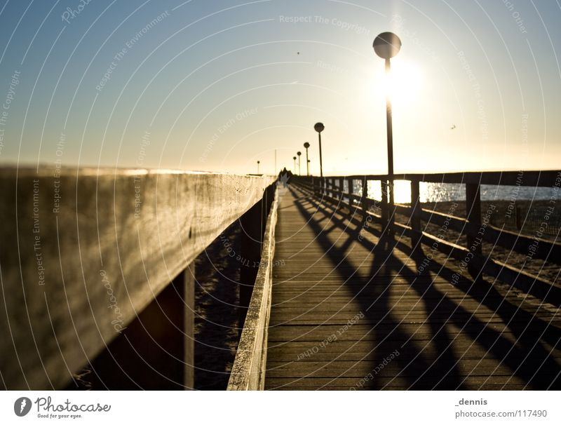 Meerwert -3°C Sonne Meer Winter Steg Ostsee Schattenspiel