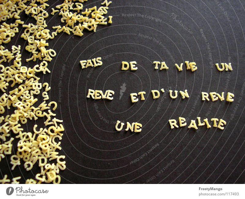 Lebe Deine Träume wirklich träumen Buchstaben Nudeln Frankreich Sprichwort Moral Leben