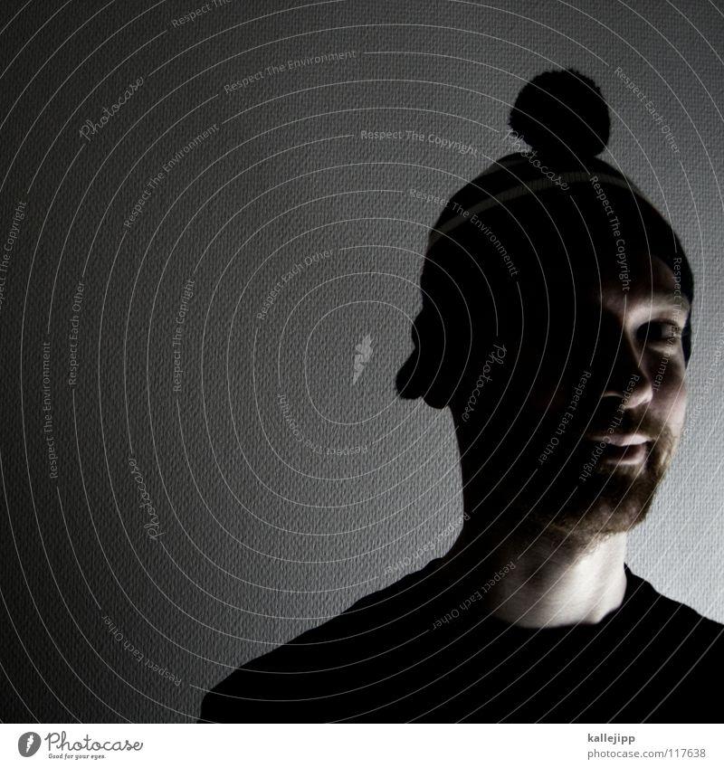 mr. bommelbastic Junger Mann Erwachsene Porträt Männergesicht Silhouette Low Key Innenaufnahme Wollmütze Kinnbart Dreitagebart unrasiert Textfreiraum links