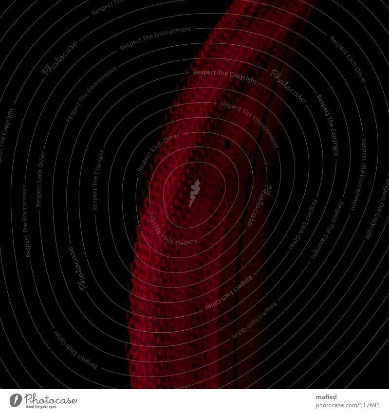 Tortellini rot schwarz glühend dunkel Kochplatte heiß Detailaufnahme glaskeramik Hintergrundbild Vor dunklem Hintergrund Bildausschnitt Anschnitt