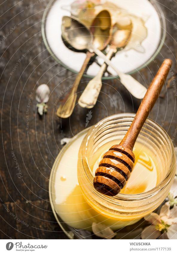 Glas mit Honig und Honiglöffel Lebensmittel Dessert Ernährung Frühstück Teller Flasche Löffel Stil Design Gesundheit Alternativmedizin Gesunde Ernährung Tisch