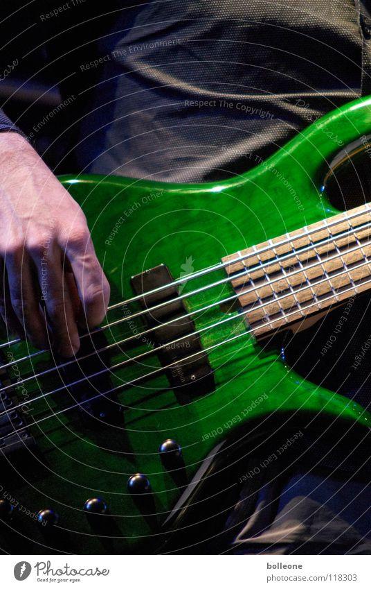 Saitenwechsel II Jazz Konzert Kunst musizieren Gebet Stimmung Klang zupfen Ton grün Lichtstimmung Musik Musikfestival Musikinstrument Kontrabass Guitar Gitarre