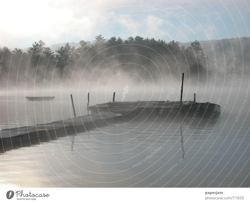 Squam Lake See Nebel Steg Wasserfahrzeug Sonnenaufgang Landschaft USA