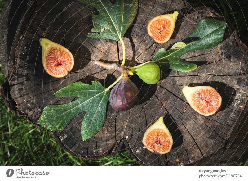 Feigen in gelber Schüssel Natur grün rot Blatt Herbst natürlich Frucht frisch exotisch Diät Vitamin saftig Hälfte geschnitten Zutaten roh