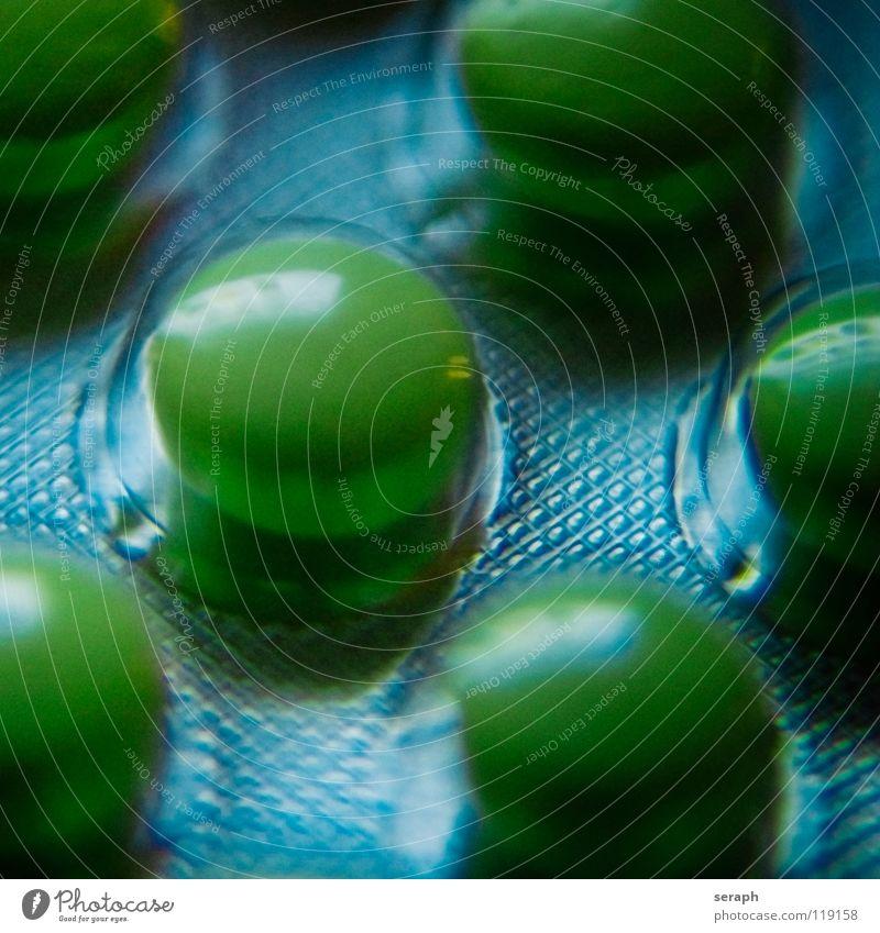 Grüne Pillen grün Gesunde Ernährung natürlich Gesundheit Gesundheitswesen Wellness Krankheit Medikament Tablette Apotheke Die Pille Kapsel Makroaufnahme Apotheker einnehmen Dragees