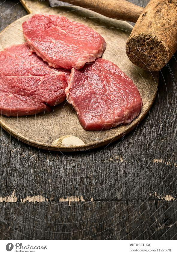 Schnitzelfleisch auf rustikalem Holztisch Gesunde Ernährung Stil Essen Hintergrundbild Lebensmittel Design Tisch retro Küche Restaurant Bioprodukte Fleisch
