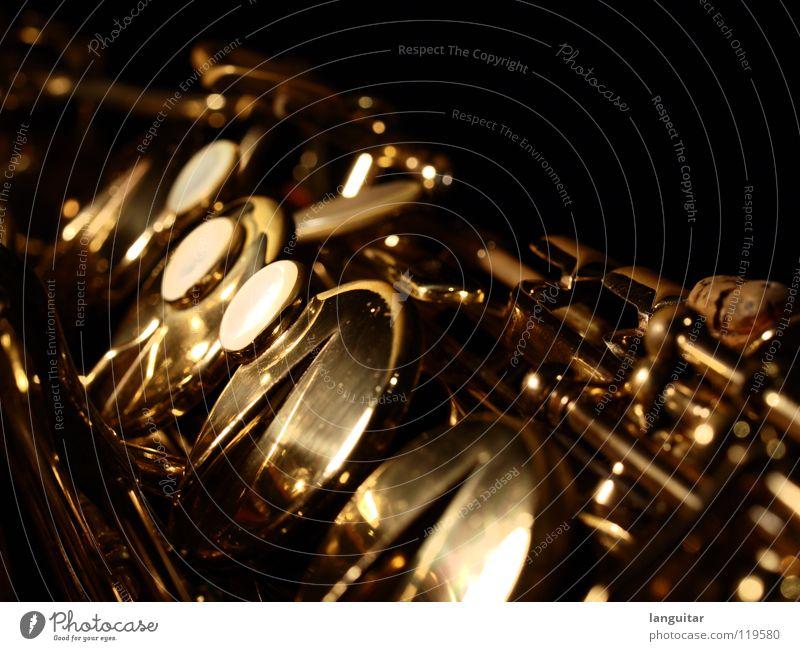 Saxophone Magic Freude dunkel Spielen Musik Metall glänzend gold außergewöhnlich Blasinstrumente Musikinstrument Swing Jazz Blues Mechanik Klappe