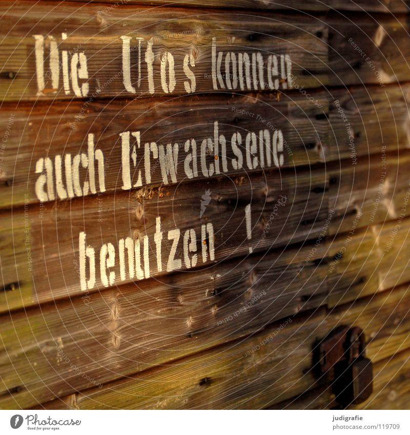 Die Ufos weiß Farbe Wand Holz Linie braun geschlossen Schriftzeichen Buchstaben Burg oder Schloss obskur Hinweisschild Typographie Schilder & Markierungen