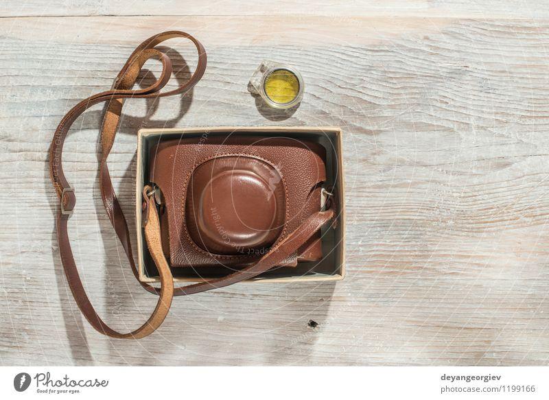 Vintage Fotokamera alt weiß schwarz Stil braun Tisch Kreativität Aussicht Fotografie retro Grafik u. Illustration Nostalgie Entwurf Linse Konsistenz