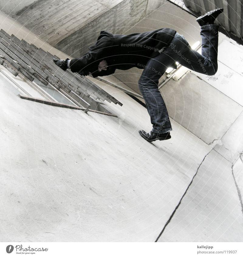 plattentanz Mann Silhouette Dieb Krimineller Ausbruch Flucht umfallen Fenster Parkhaus Geometrie Gegenlicht Jacke Mantel Mütze Thriller Handschuhe ausbreiten