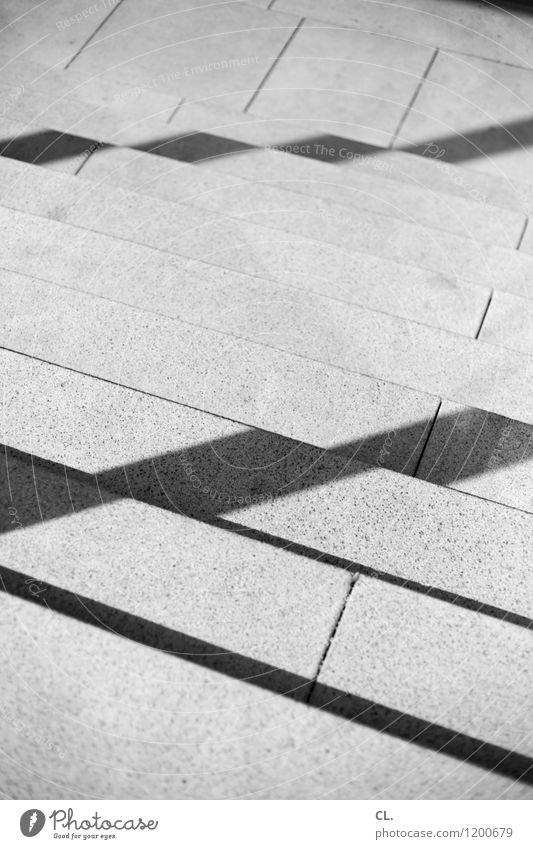 stufen Treppe Linie Stein eckig Wege & Pfade abwärts Schwarzweißfoto Außenaufnahme abstrakt Menschenleer Tag Licht Schatten
