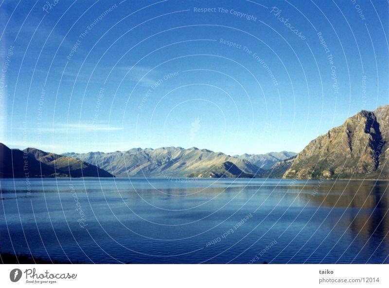 Lake Wanaka Natur Wasser Himmel Wolken Berge u. Gebirge grau Stein See Landschaft Felsen Schönes Wetter Australien beige Neuseeland Himmelszelt Firmament