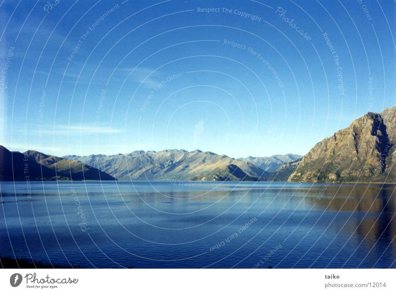 Lake Wanaka See beige Neuseeland Südinsel Himmel Natur grau Wolken Schönes Wetter Australien Berge u. Gebirge fawn lake mountain mountains sky Wasser water blue