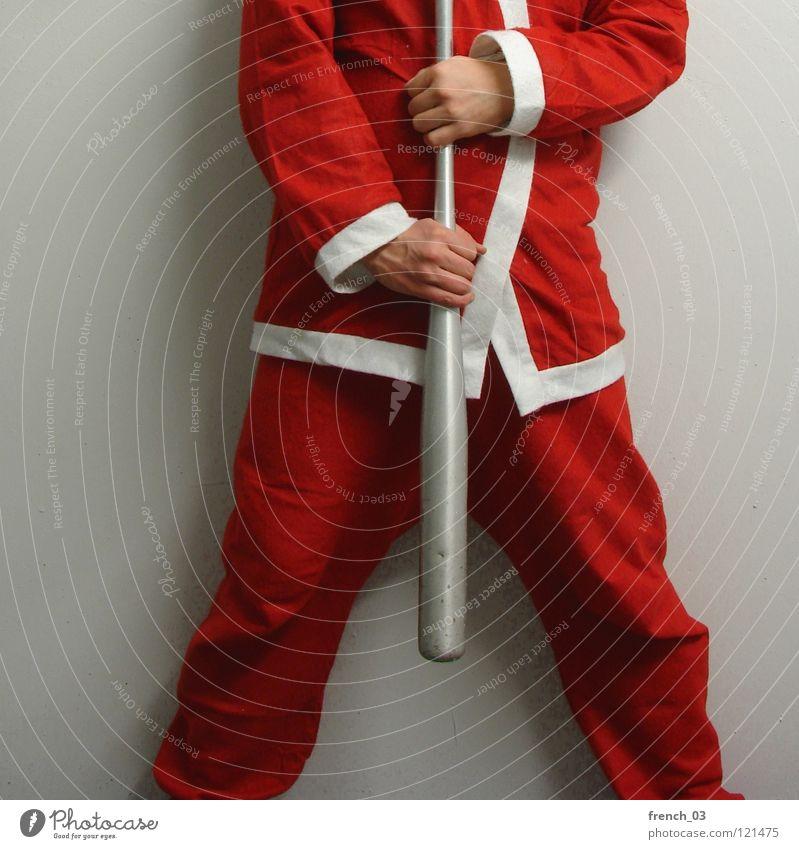 Wart ihr alle brav? festlich Feiertag Weihnachtsmann rot weiß Kittel Mann Hand Hose Anzug gekreuzt Wand grau Schatten kopflos Trauer Zusammensein Feste & Feiern