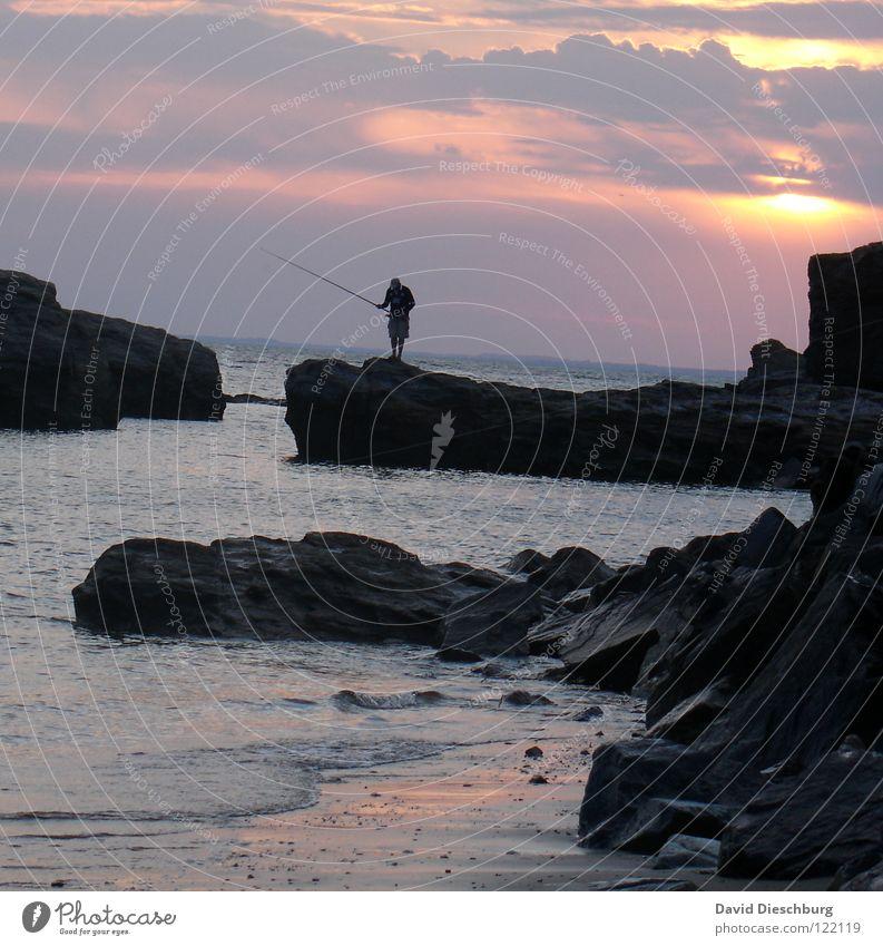 The lonely angler #II Wasser Himmel Sonne Meer blau Sommer Strand Ferien & Urlaub & Reisen schwarz Wolken Einsamkeit gelb Berge u. Gebirge Stein Sand hell
