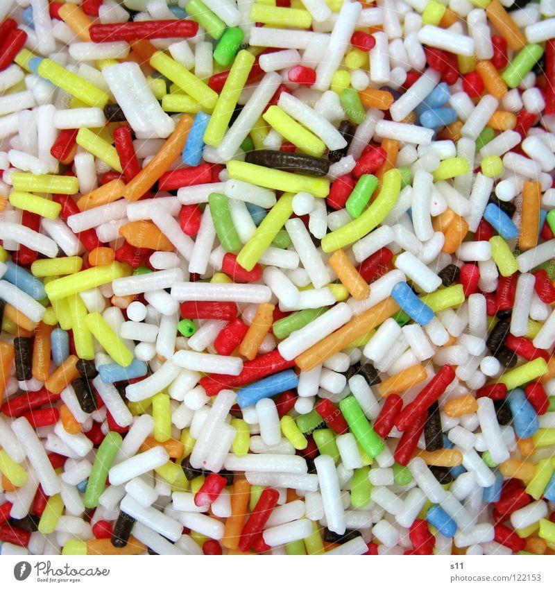 Zuckerstreusel II Ernährung klein süß blau gelb grün rot weiß verteilen Streusel Backwaren kochen & garen mehrfarbig Nahaufnahme Makroaufnahme backen