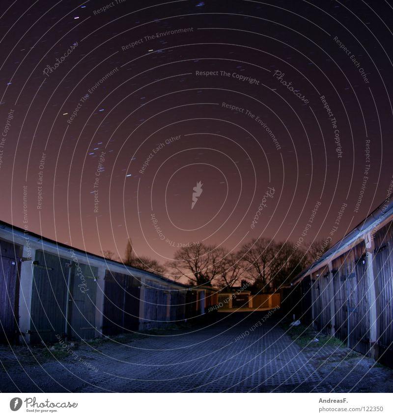 Großstadtfeuer Stern Dämmerung Nacht Planet Stadt Cottbus Dach Garage Nachtaufnahme Himmel violett Tierkreiszeichen Komet Nachthimmel Langzeitbelichtung