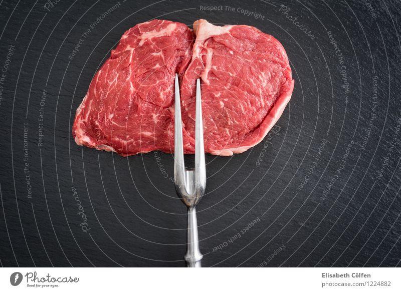 Rib-Eye-Steak rot schwarz ökologisch Fleisch roh Gabel Rindfleisch