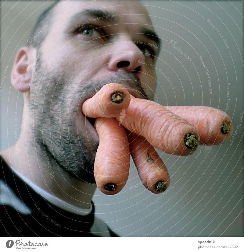 Junges Gemüse #4 | Den Hals nicht vollkriegen Porträt Männergesicht Junger Mann 18-30 Jahre 1 Mensch Ein junger erwachsener Mann einzeln Wegsehen Möhre