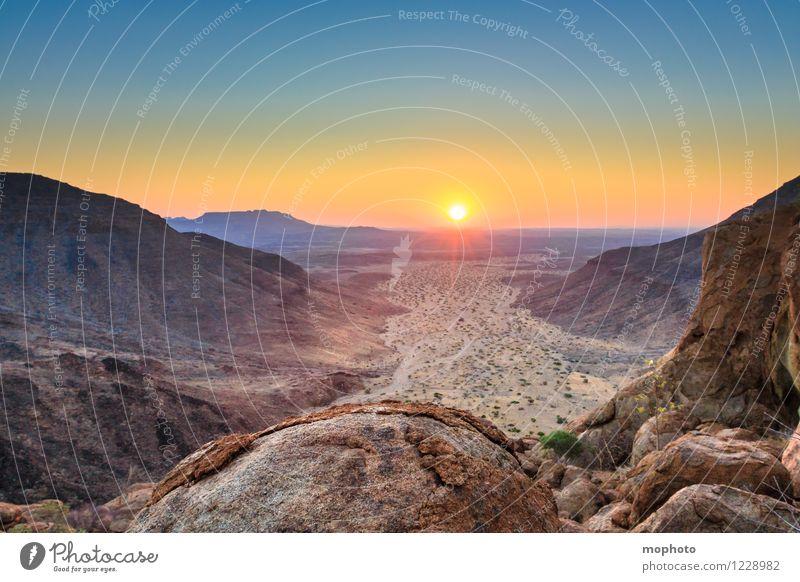 Am Ende des Tages Natur Ferien & Urlaub & Reisen blau Farbe Sonne Landschaft Ferne gelb Wärme natürlich braun Felsen Idylle gold ästhetisch Schönes Wetter