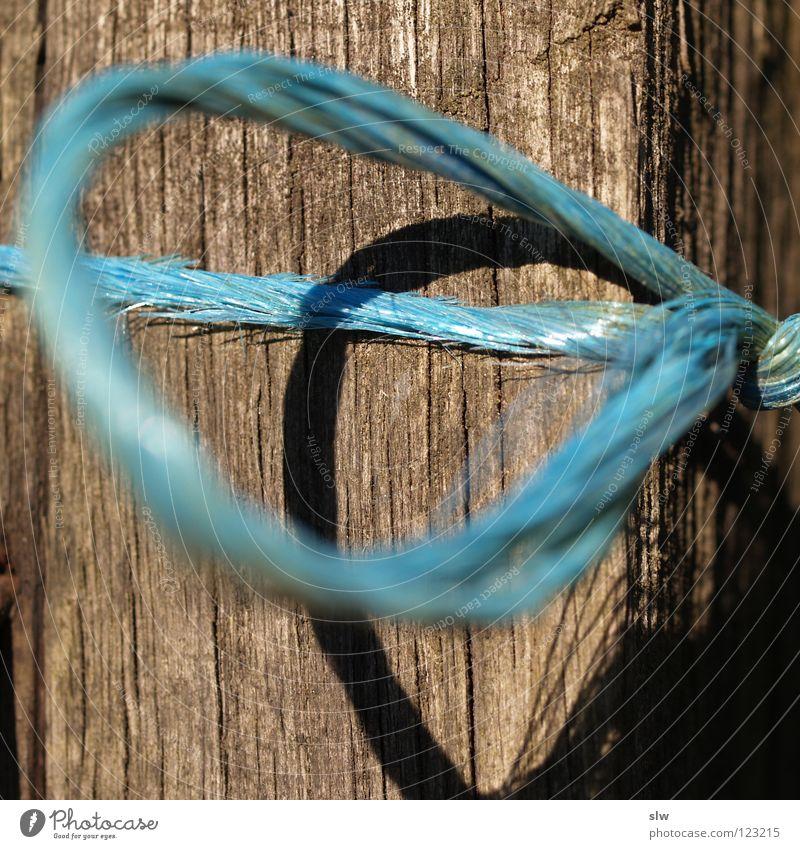 BlauesBand grau blau-grau Leitfaden Seil Unschärfe Holz Makroaufnahme Nahaufnahme Schnur Nähgarn Nervosität Knoten