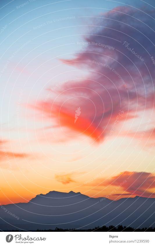 Berg in Marokko Himmel Natur Ferien & Urlaub & Reisen blau schön Farbe Sommer Sonne rot Landschaft Wolken Winter dunkel Berge u. Gebirge gelb Felsen