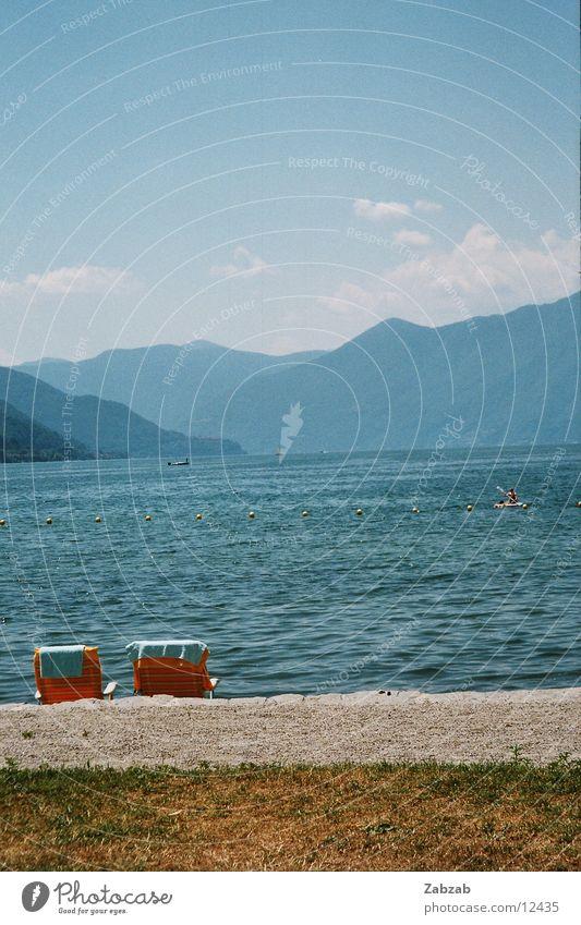 Beach Wasser Ferien & Urlaub & Reisen Wolken Berge u. Gebirge Sand Wasserfahrzeug Rasen Schweiz Liegestuhl Kanton Tessin
