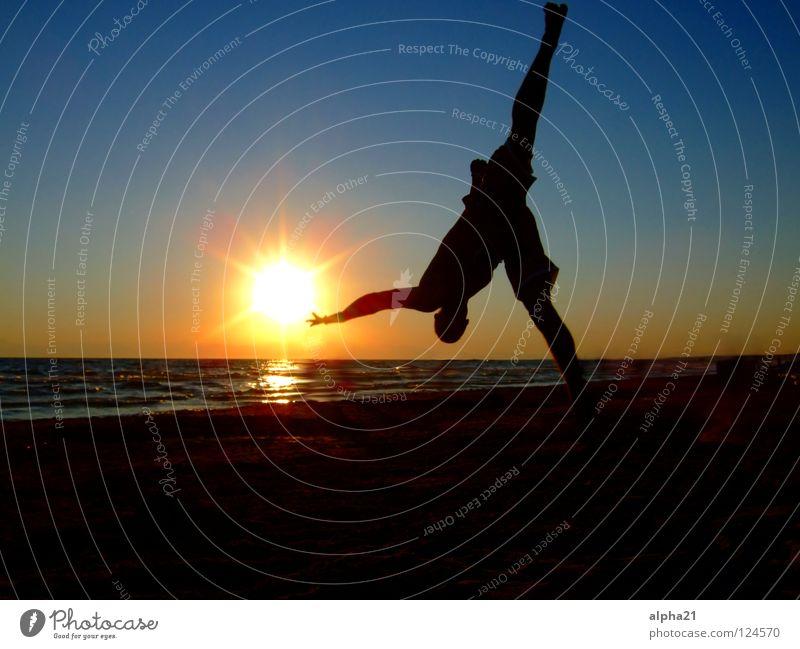 Reaching for the Sun Sonnenuntergang Strand Trick Ferien & Urlaub & Reisen Meer Arkobatik Sport