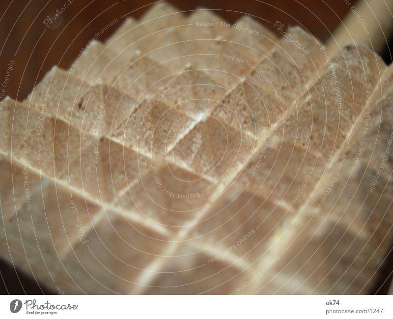 Fleischklopfer braun Küche Makroaufnahme Pyramide
