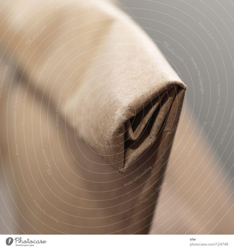 Packpapier schwarz grau braun Papier Überraschung Rolle einpacken