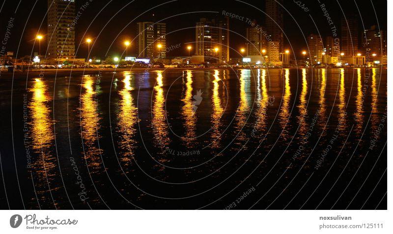 Light on water gelb Licht Wahrzeichen Denkmal dark night sea black Sepia light distant