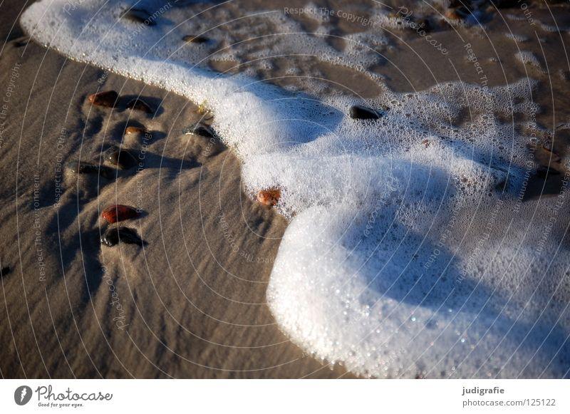 Strand Küste Gischt Luft Schaum salzig fein nass See Meer Weststrand schön Umwelt ruhig Ferien & Urlaub & Reisen Farbe Sand Stein Wasser blasen Salz