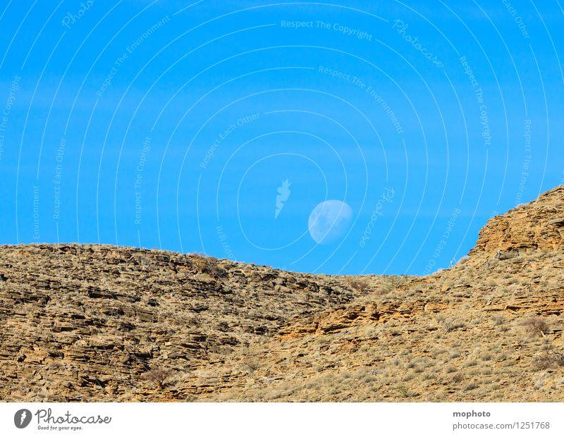 Voll der Mond Natur Ferien & Urlaub & Reisen blau Landschaft Umwelt natürlich Stein braun Sand Felsen Horizont wild Tourismus Idylle Klima Schönes Wetter
