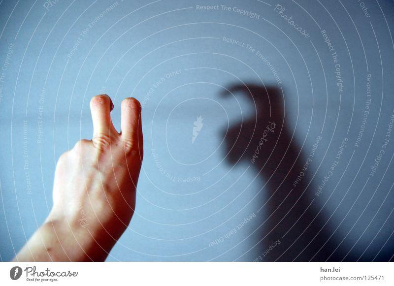 Frohe Ostern Mensch Hand Finger Langeweile Osterhase Abschied Licht Schatten Schattenspiel Wand Fantasygeschichte gestikulieren Textfreiraum oben