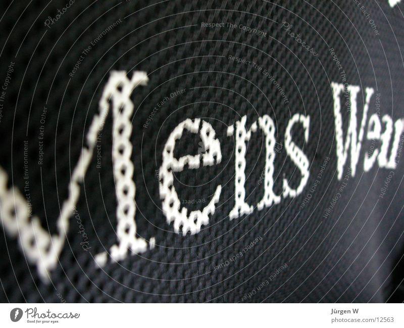 Mens Wear schwarz Bekleidung Schriftzeichen Typographie Fototechnik