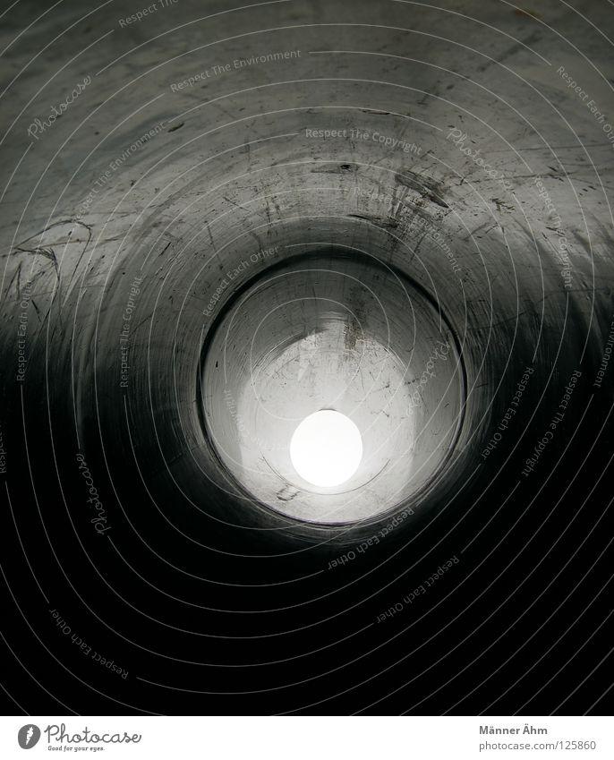 Ab durchs Loch... Rutsche Spielplatz Spielen toben Geschwindigkeit schwarz Licht Tunnel Höhle Himmelskörper & Weltall Freude Sand Sonne Lichterscheinung