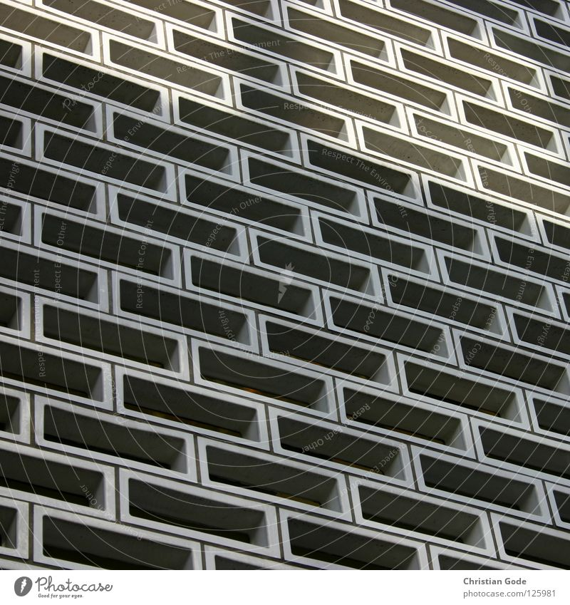 Quadrat? Haus Muster Fassade Rechteck Fenster Kasten Beton Lichteinfall wahrnehmen Fächer rechtwinklig Ornament Nut Architektur Detailaufnahme Deutschland
