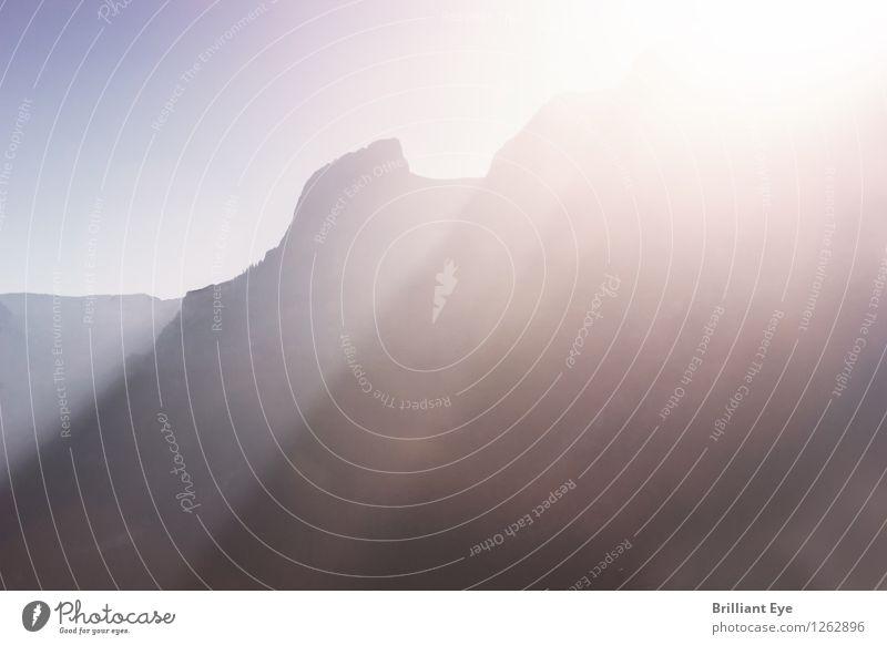 Sonnenlicht über Bergkette Tourismus Ferne Sommer Natur Sonnenaufgang Sonnenuntergang Hügel Felsen Alpen Berge u. Gebirge ästhetisch positiv gelb Optimismus