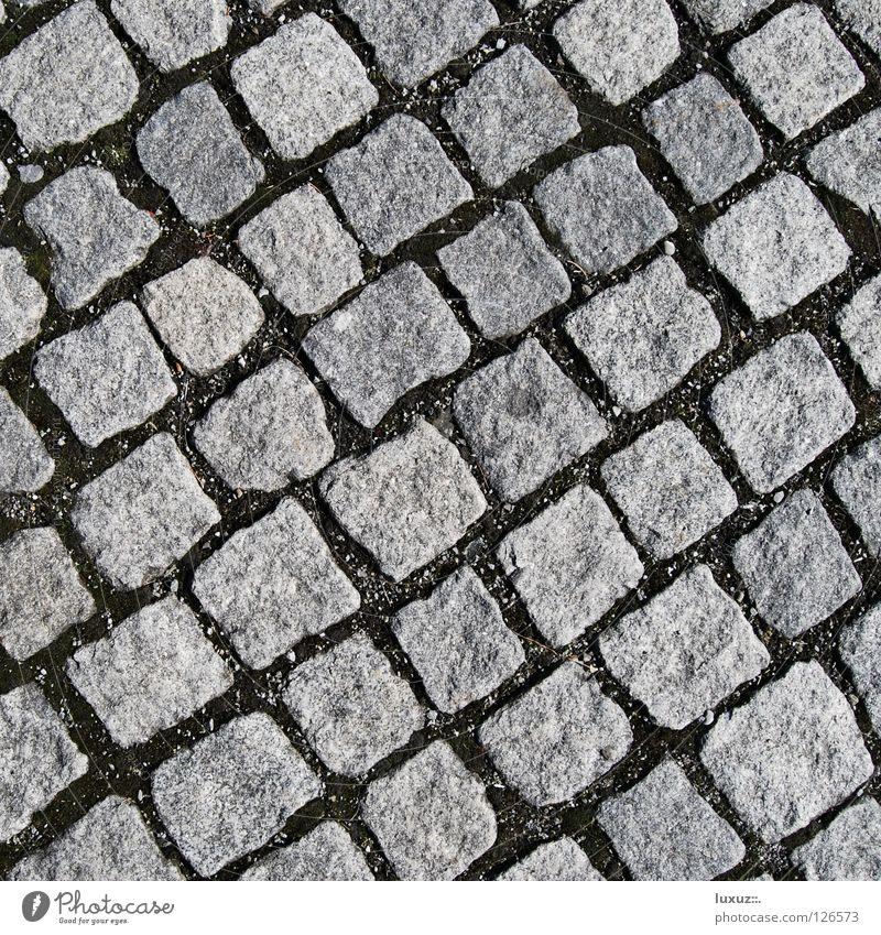 Stein um Stein Straße grau Verkehr Platz Bodenbelag Quadrat Handwerk Reihe Kopfsteinpflaster diagonal Parkplatz Anordnung hart Pflastersteine Marktplatz