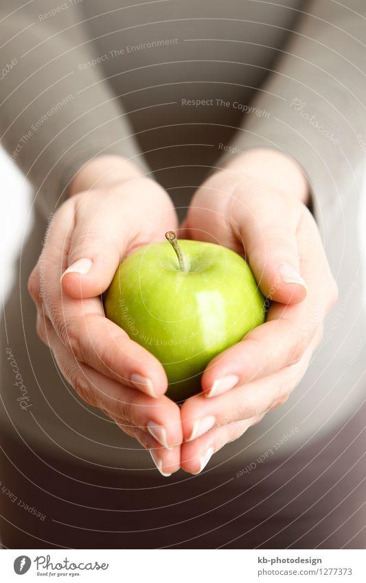 Woman holding one green apple Mensch Frau Hand Erwachsene feminin Essen Gesundheit Lebensmittel Wellness Wohlgefühl Apfel Diät Yoga Joggen Vegane Ernährung