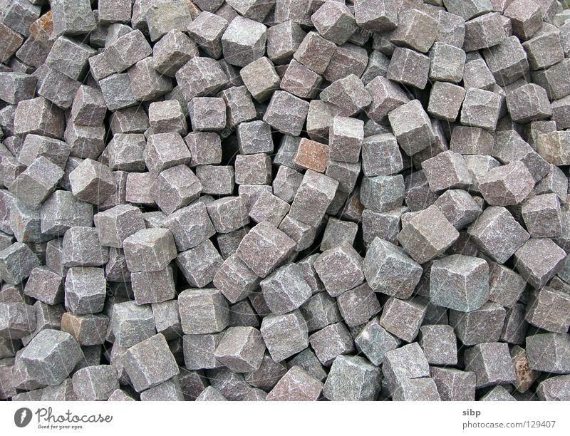 Bauklötzchen für Große grau Stein mehrere Baustelle Hügel Handwerk Kopfsteinpflaster viele Pflastersteine Haufen Quader Straßenbau
