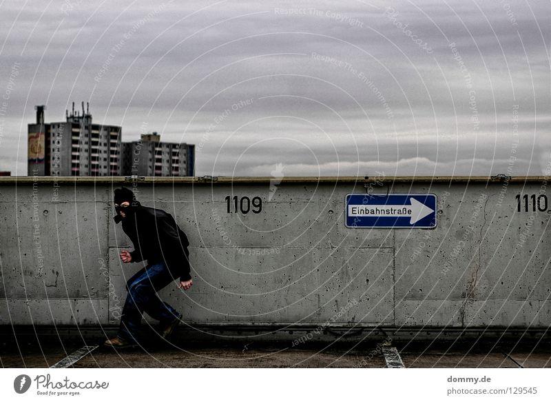 Welcome BLACKHEAD Mann Kerl schwarz dunkel Einbahnstraße Parkdeck parken Parkhaus Hochhaus dreckig Ziffern & Zahlen Jacke kalt Winter Wolken brechen Dieb black