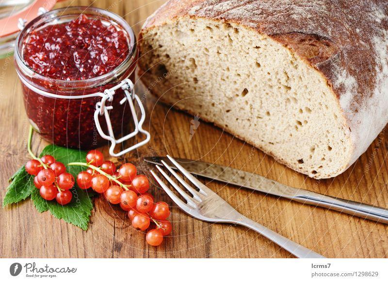 red currant jam and fresh bread Frucht Brot Marmelade Ernährung Frühstück Besteck Messer Gabel Essen currants breakfast fruit bowl blue white table wood