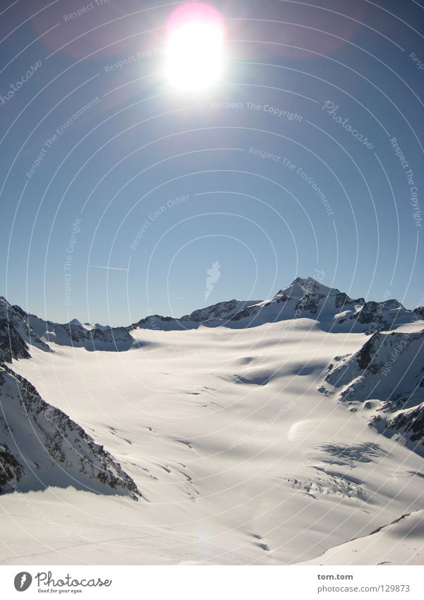 Gletscher - blue sky high Himmel Ferien & Urlaub & Reisen blau weiß Sonne Landschaft Ferne Winter kalt Berge u. Gebirge Schnee Glück Freiheit fliegen Felsen
