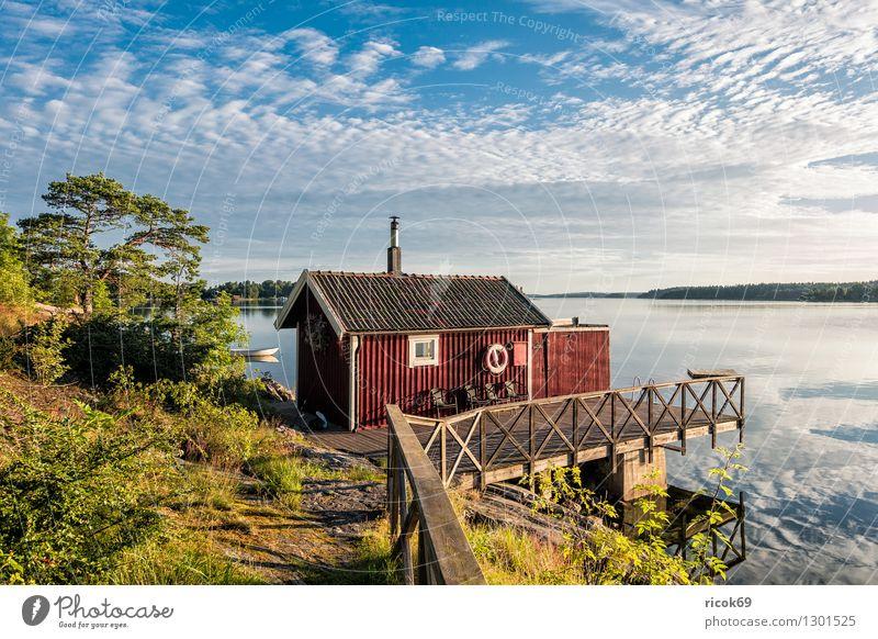Schärengarten an der schwedischen Küste Erholung Ferien & Urlaub & Reisen Tourismus Insel Natur Landschaft Wolken Baum Ostsee blau grün Schweden Holzhaus