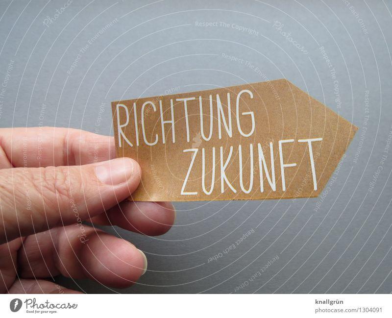 RICHTUNG ZUKUNFT Hand Finger Schriftzeichen Schilder & Markierungen festhalten Kommunizieren eckig braun grau Gefühle Stimmung Optimismus Neugier Hoffnung