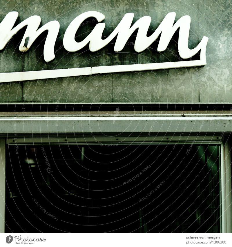 """mann Köln Stadt Stadtzentrum Mauer Wand Fassade Fenster Stein alt authentisch außergewöhnlich trendy schwarz silber türkis weiß """"Reklame Schild Werbung Name"""