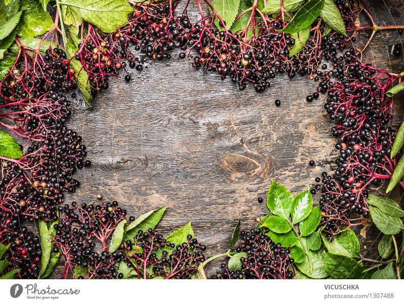 Holz Hintergrund mit Holunderbeeren Lebensmittel Frucht Dessert Marmelade Ernährung Bioprodukte Vegetarische Ernährung Diät Stil Design Gesunde Ernährung Garten
